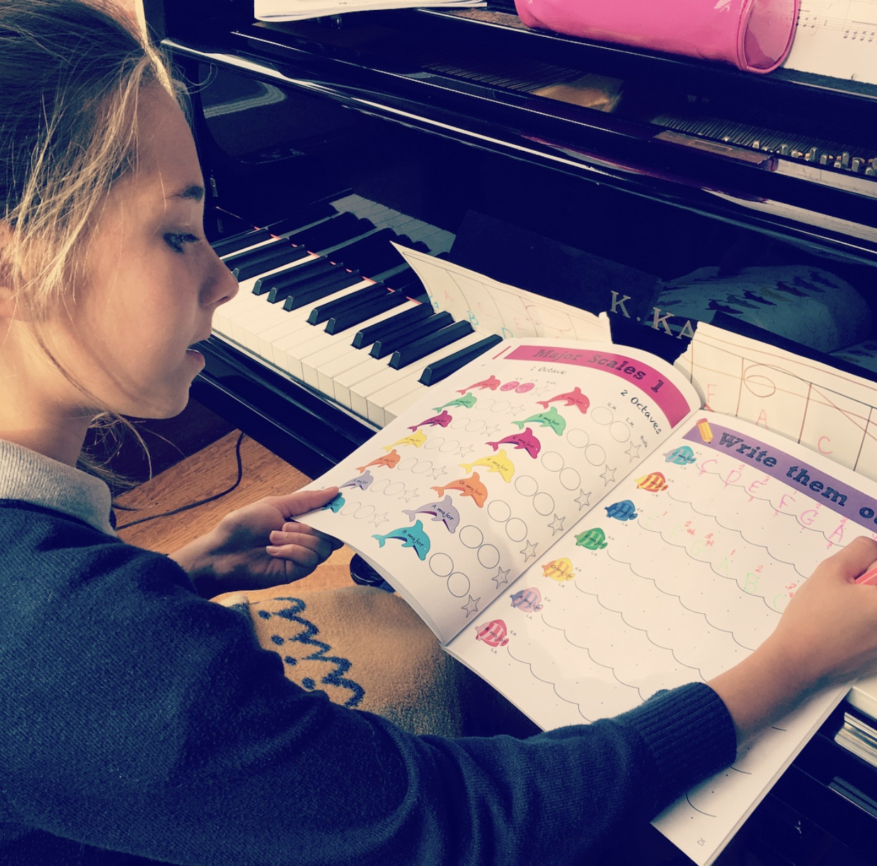 A student using the workbook pages in the Cascade Method Piano Theory Book