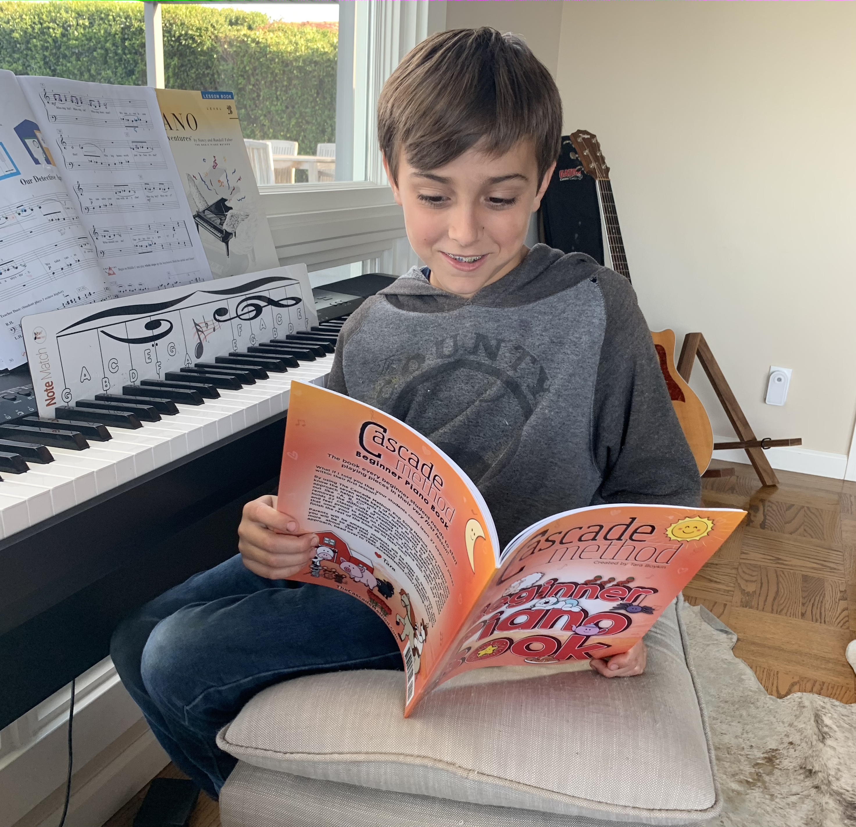 Young boy looking through the Piano Beginner Book