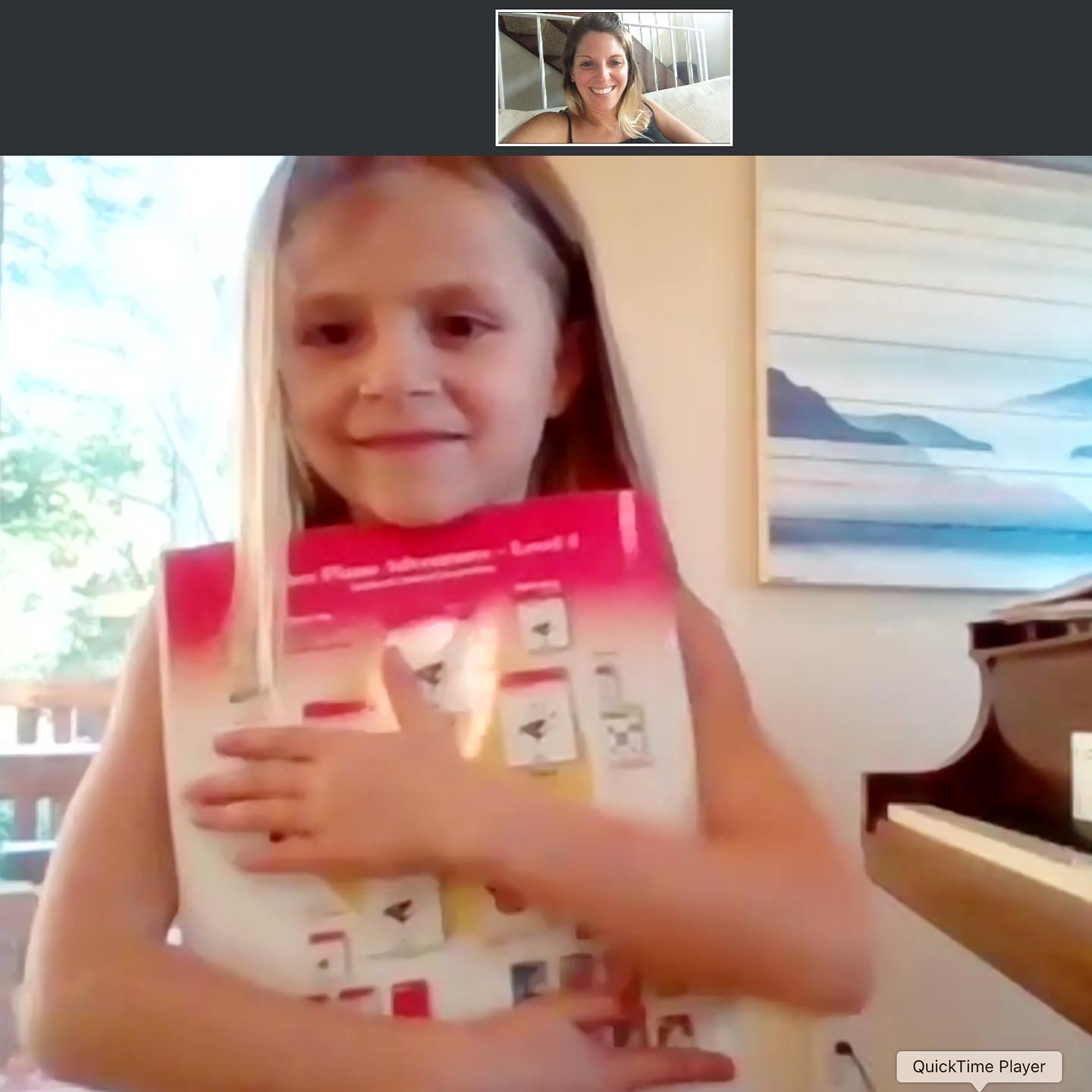Teagan on Facetime with Tara for virtual piano lessons